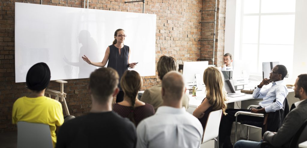 Woman presenting to a group in a meeting