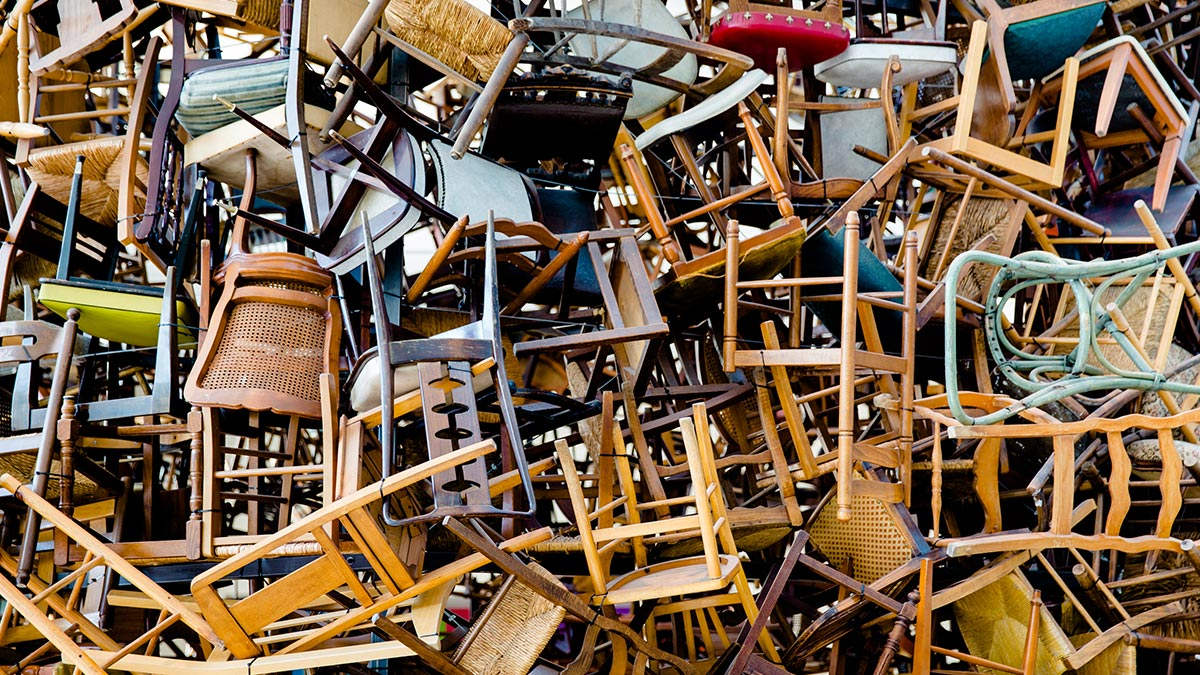 A chaotic pile of chairs represents a guide to running meetings