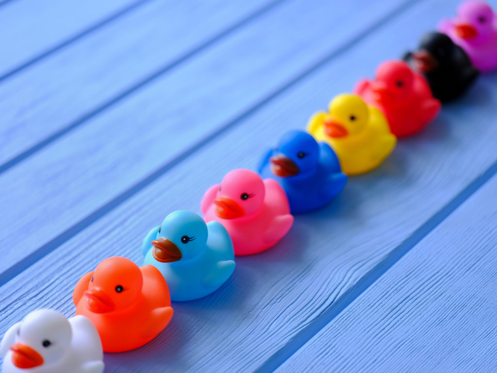 Behavioral data in the workplace represented by a row of rubber ducks, Credit:enviromantic