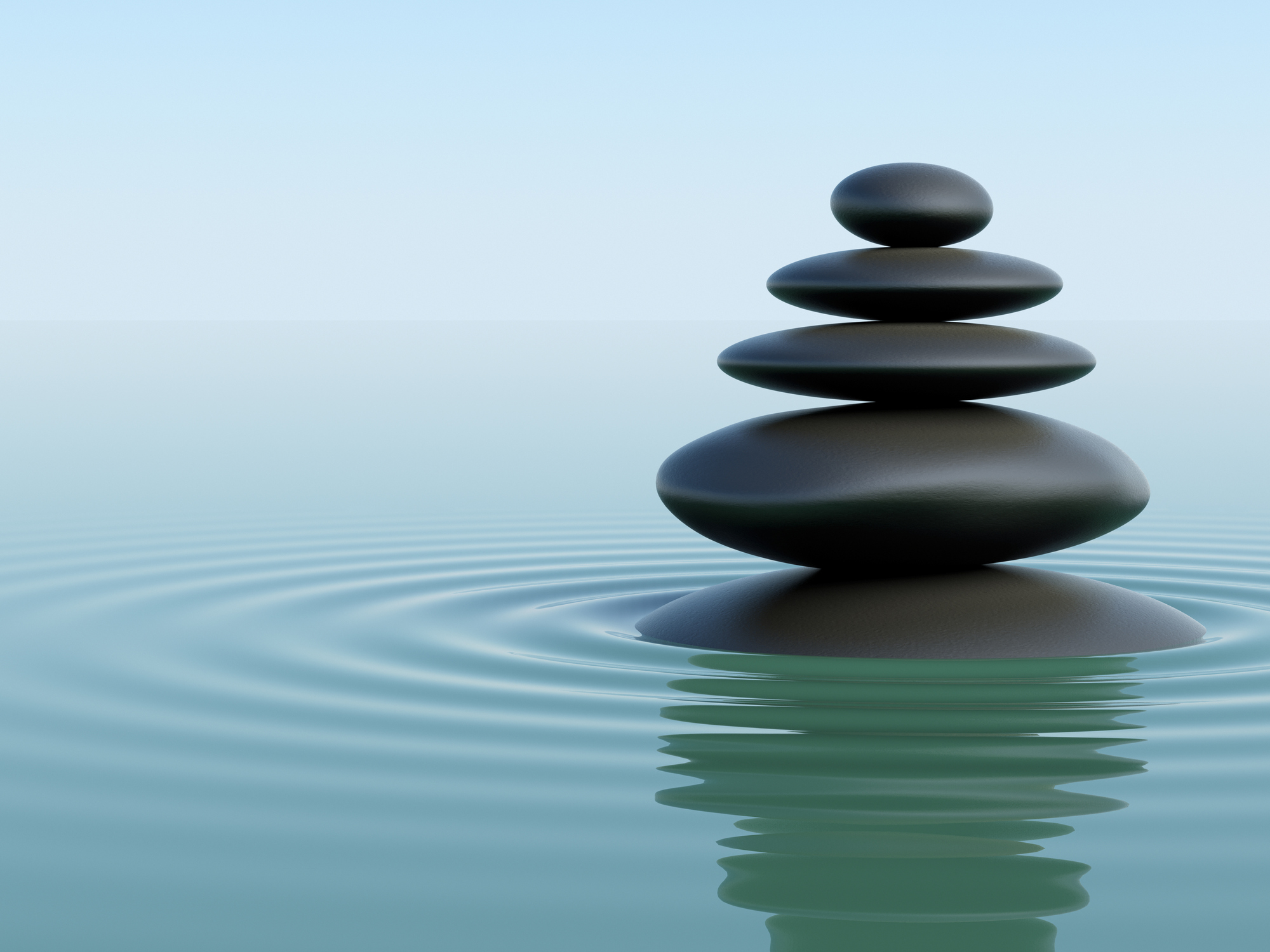 A stack of balanced stones represent holistic employee engagement.