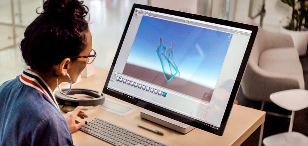 Woman at computer developing AI