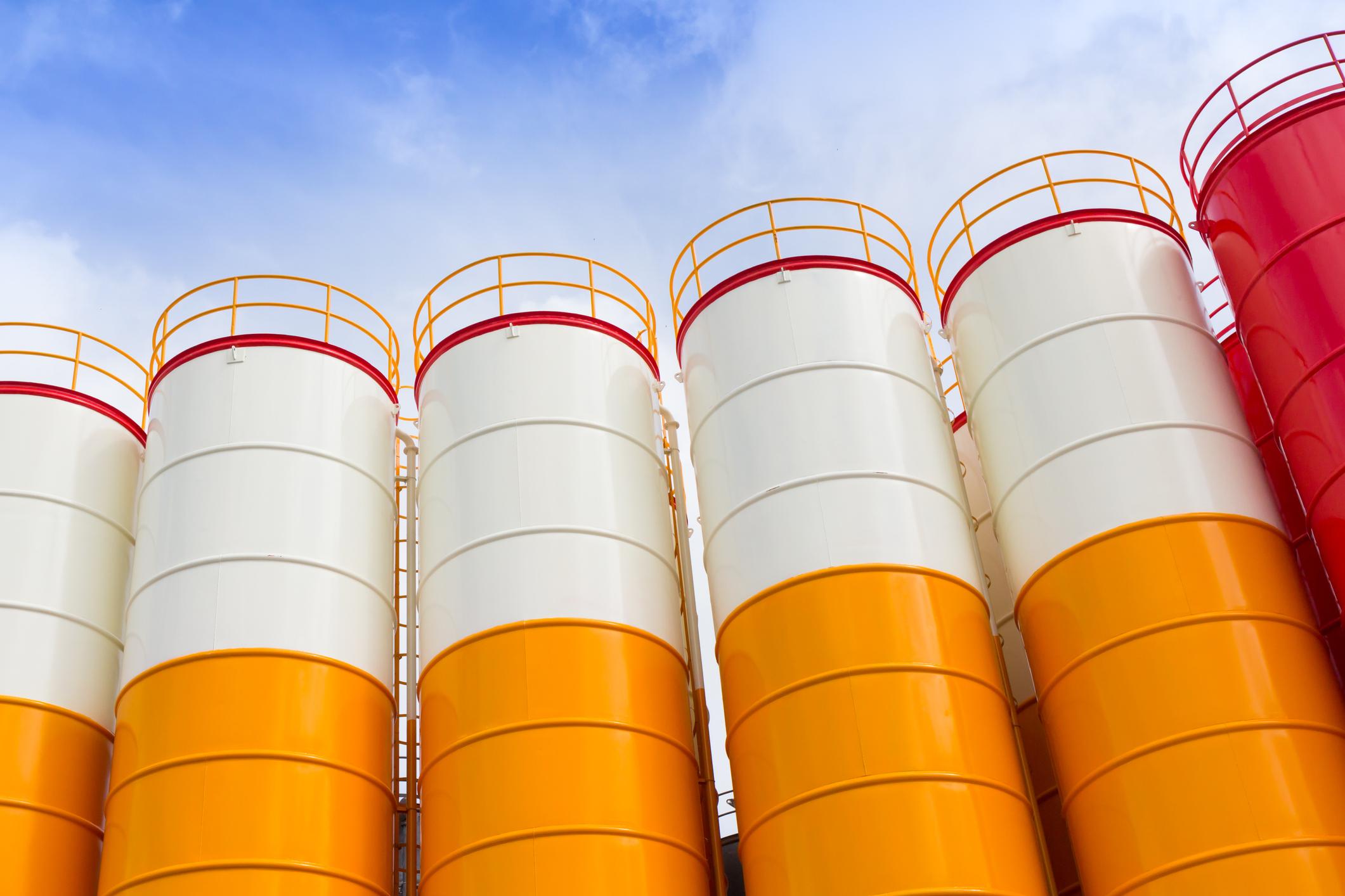 Row of farm silos representing cross-silo leadership and horizontal collaboration