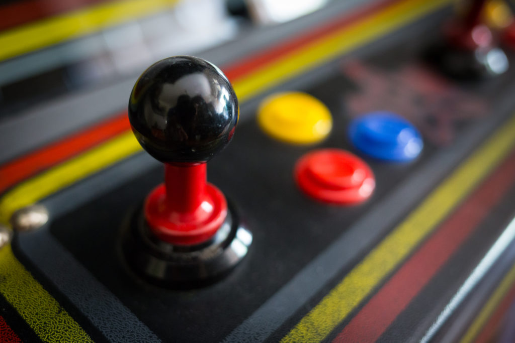Video arcade game joystick and three console buttons