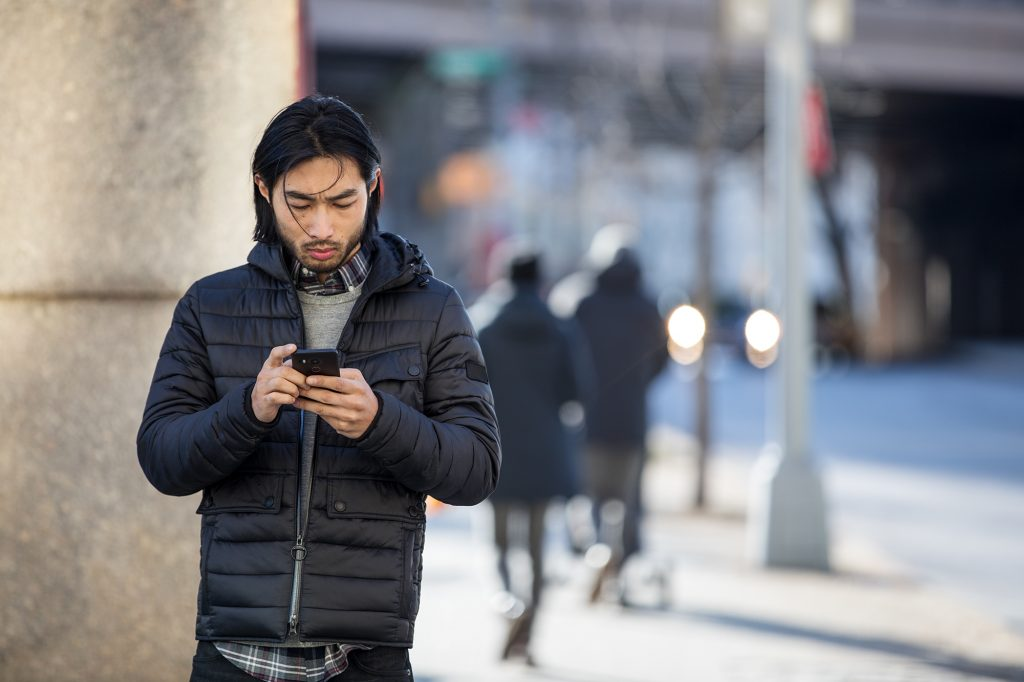 Man on phone walking in street