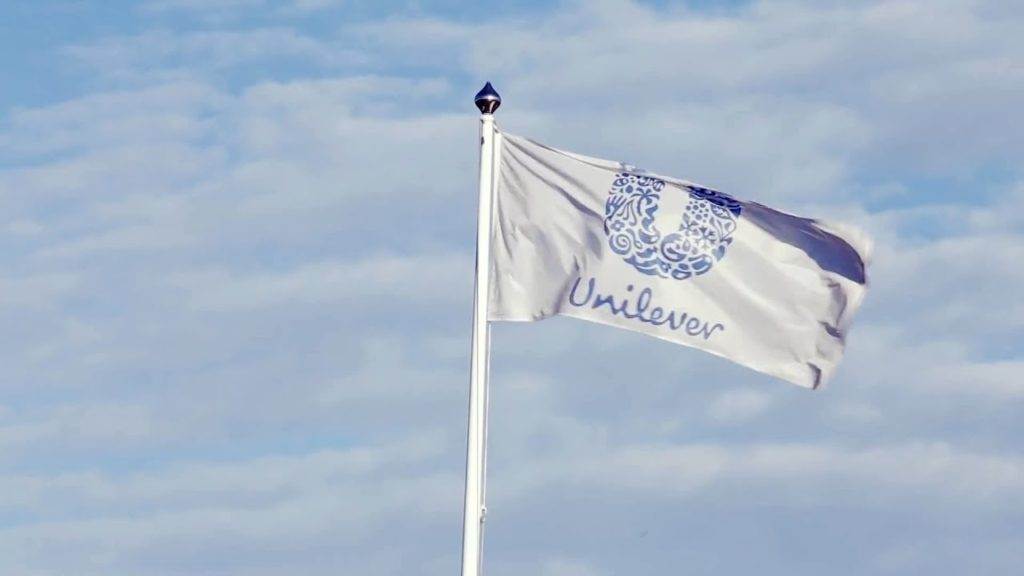 Unilever flag flying with the sky in the backround